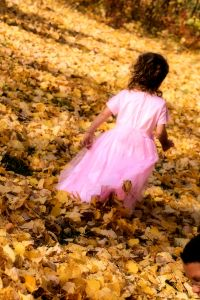 little-girl-in-dress-running-in-leaves-1111628-m